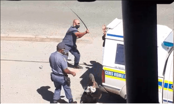 Police officers caught heavily beating up 2 men