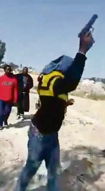 zama zamas waving guns while singing angers South Africans