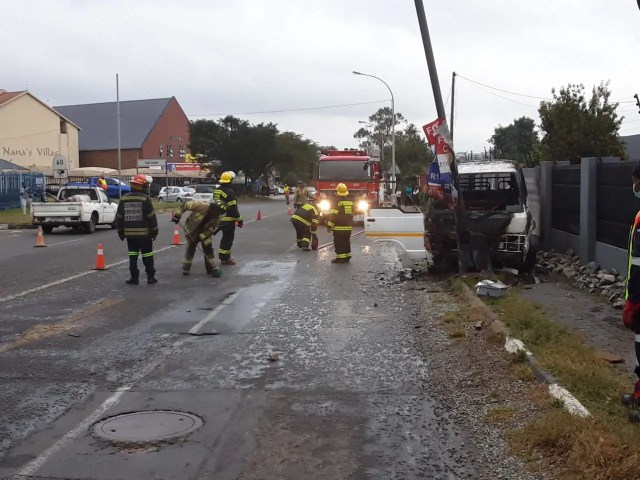 Taxi bursts into flames after hitting pedestrian and light pole
