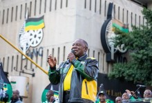 President of the African National Congress (ANC) Cyril Ramaphosa gestures as he delivers a speech outside Luthuli House
