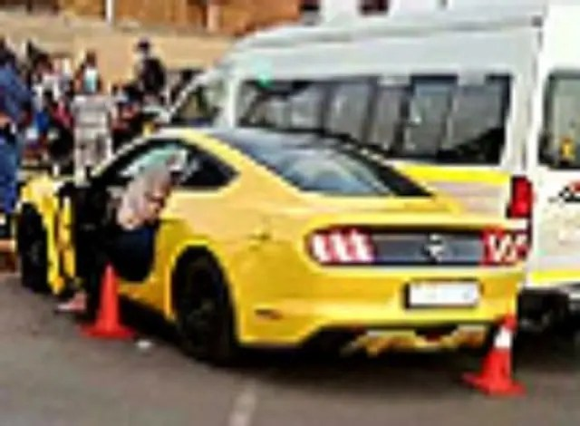 Taxi owner shoots his ex-girlfriend and her boyfriend driving in his Ford Mustang