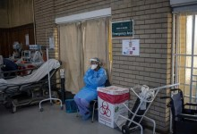 COVID-19 coronavirus healthcare worker looks at the hall where people are getting vaccinated at the Bertha Gxowa Hospital in Germiston