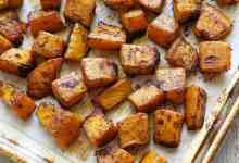 """An easy recipe for savoury baked pumpkin, seasoned with olive oil, garlic, and chilli powder. It's such a wonderful side dish. Oven-roasting is one of my favourite ways to make this tasty winter squash! When you think about pumpkin, do you only think about pumpkin pie? If so, you're missing out! Pumpkin can take on either sweet or savoury flavours, and it makes a wonderful, hearty, and satisfying savoury side dish, perfect for fall and winter. I actually think I like savoury pumpkin dishes better than I like sweet ones. I love chocolate and cheesecake desserts much more than pumpkin desserts. But savoury pumpkin dishes are amazing. INGREDIENTS You'll only need FIVE simple ingredients to roast a pumpkin! The exact measurements are included in the recipe card below. Here's an overview of what you'll need: Sugar pumpkin: Small pumpkins are more flavorful. They do vary in size, from 2 lb. to 5 lb., but whatever their size, as long as they are marked as """"sugar pumpkin"""" or """"sugar pie pumpkin,"""" that's what you need. Olive oil: I love cooking with this delicious oil. Melted butter is another tasty option. Seasonings: I use kosher salt, chilli powder, and garlic powder. In this particular recipe, I prefer garlic powder to minced fresh garlic, because it more evenly coats the pumpkin. INSTRUCTIONS So how do you roast pumpkin? In this easy recipe, the pumpkin is seasoned with olive oil, garlic, and chilli powder. Then it's baked in a hot oven until tender. This flavour combination is phenomenal! Please scroll down to the recipe card for detailed instructions. Here are the basic steps: Your first step is to slightly soften the pumpkin in the microwave, then carefully cut it in half and remove the pulp and seeds. Next, you cut each pumpkin half into four 1-inch-thick moon-shaped slices. Use a vegetable peeler to peel the skin off. Cut the peeled pumpkin slices into cubes. Place the pumpkin cubes in a large bowl and coat them with olive oil and spices. Transfer the seasoned pumpk"""
