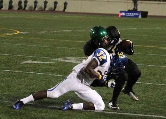 A Crenshaw defender lowers the boom on a Narbonne offensive player. Photo Credit: Jevone Moore/News4usonline.com