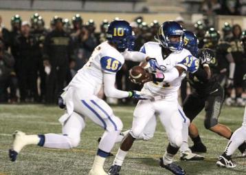 """Ajene Harris (11) running the spread offense against Narbonne. Photo Credit"""" Jevone Moore/News4usonline.com"""