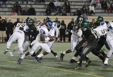 Crenshaw quarterback Ajene Harris (11) makes something happen. Photo Credit: Jevone Moore/News4usonline.com