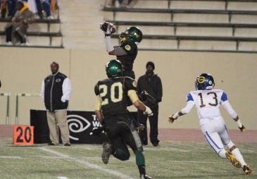 Flying high: A Narbonne defender gets airborne . Photo Credit: Jevone Moore/News4usonline.com