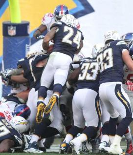 A defensive surge by the Chargers. Photo Credit: Kevin Reece/News4usonline.com