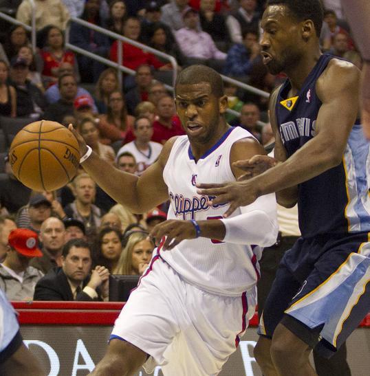 Chris Paul go to work against Tony Allen of the Memphis Grizzlies. Photo Credit: Jevone Moore/News4usonline.com
