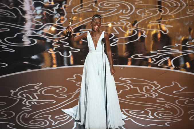 LUPITA NYONG'O celebrates winning the Academy Award for Best Supporting Actress.  THE OSCARS(r) - THEATRE - The Academy Awards(r) for outstanding film achievements of 2013 presented on Oscar Sunday, March 2, at the Dolby Theatre(r) at Hollywood & Highland Center(r) and televised live on the ABC Television Network. (ABC/Adam Taylor)