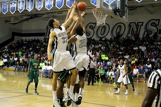 All in: Mayfair High School and Long Beach Poly players get to the rim in a CIF State playoff tournament game at Mayfair High School. Mayfair defeated Poly, 82-73. Photo: Dennis Freeman/News4usonline.com