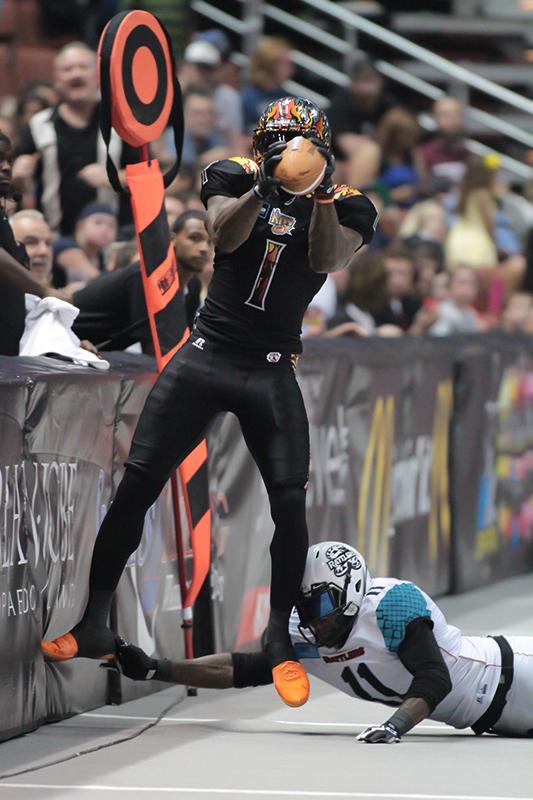 "Wide Receiver Donovan ""Captain"" Morgan on a big catch on a scoring drive. Photo Credit: Jevone Moore / News4usonline.com"