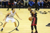 Manu Ginobili looks to slow down Miami's Dwayne Wade during the 2014 NBA Finals. Photo Credit: Antonio Uzeta/News4usonline.com