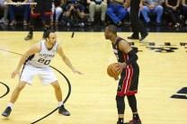 Manu Ginobili looks to slow down Miami's Dwayne Wade during the 2014 NBA Finals. Photo Credit: Antonio Uzeta/News4usonline.com