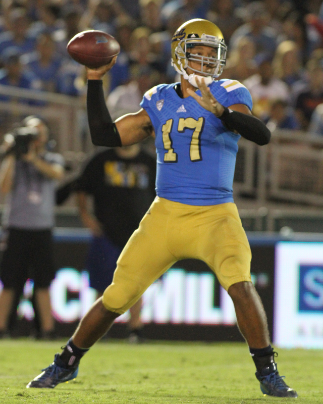 UCLA field  general Brett Hundley looking down field to strike a target. Photo Credit : Jevone Moore Courtesy of Full Image 360 / News4usonline.com