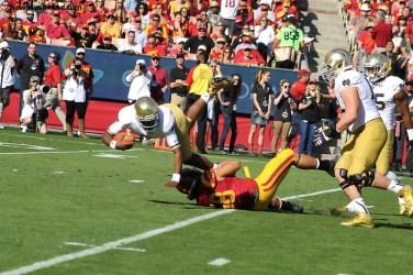Notre Dame quarterback gets ready to eat some Coliseum turf after being hit by a USC defender. Photo Credit: Dennis J. Freeman/News4usonline.com