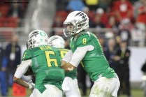 Marcus Mariota gets ready to pull the option-read play against Arizona in the Ducks' 51-13 win on Friday, Dec. 5. Photo Credit: Jevone Moore/News4usonline.com
