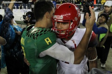 Oregon QB Marcus Mariota greets Ariozna's Anu Solomon after the Ducks beat the Wildcats 51-13 to claim the Pac-12 title. Photo Credit: Jevone Moore/News4usonline.com