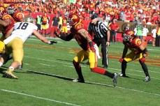 A USC defender makes a move to get to get in the Fighting Irish backfield. Photo Credit: Dennis J. Freeman/News4usonline.com