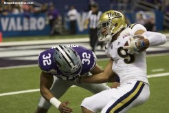 Kansas State defender Justin Silmon tries to make a play against UCLA wide receiver Jordan Payton. Photo by Antonio Uzeta/News4usonline.com