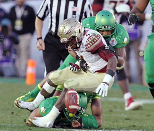 Florida State running back Dalvin Cook gets hammered by several Oregon players and commits one of two fumbles he lost. Courtesy photos