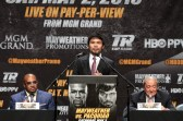 Manny Pacquiao speaks to a huge throng of reporters in downtown Los Angeles