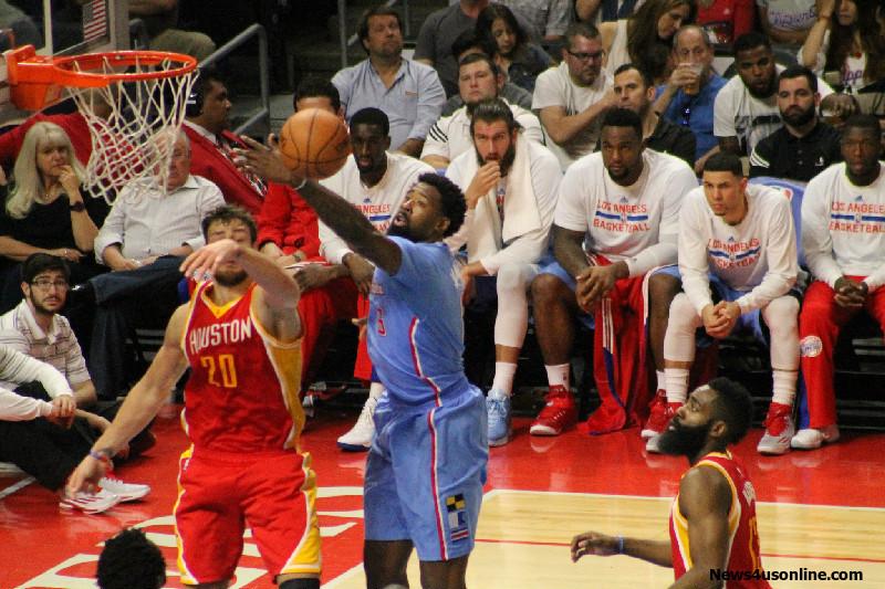 DeAndre Jordan goes after one of his 20 rebounds against the Houston Rockets on Sunday, March 15, 2015. Photo Credit: Dennis J. Freeman/News4usonline.com