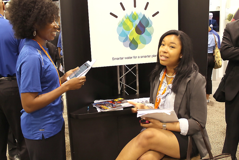 Dartmouth University student Coralie Phanord speaks to a job recruiter at the job fair part of the 41st National Society of Black Engineers (NSBE) Annual Convention in Anaheim, California. Photo Credit: Dennis J. Freeman/News4usonline.com