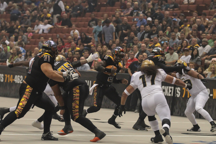 Quarterback Adrian McPherson using his legs for a first down. Photo by Jevone Moore