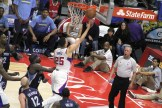 To the rack: Austin Rivers scores two of his four points on this layup while Memphis forward Zach Randolph looks on. Photo Credit: Dennis J. Freeman/News4usonline.com