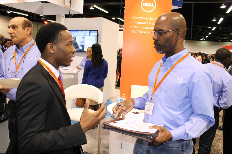 DELL representative Joe Balentine gives a job seeker some advice at the National Society of Black Engineers (NSBE) 41st Annual Convention in Anaheim, California. Photo Credit: Dennis J. Freeman/News4usonline.com