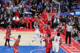 The Clippers' Matt Barnes gets twisted in the air on a drive. Photo by Jevone Moore/News4usonline.com