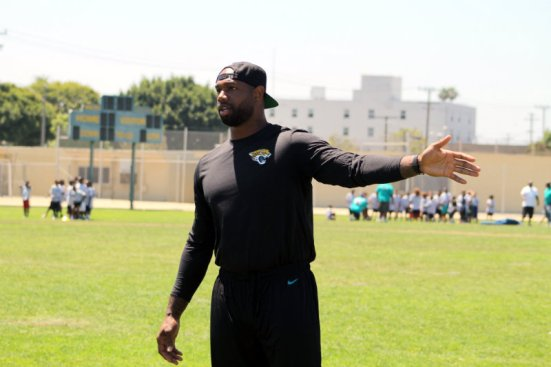 Jacksonville jaguars tight end Marcedes Lewis demonstrates how run a certain passing route to a group of attendees of the 7th Annual Marcedes Lewis Football Camp on Saturday, June 2015. Photo by Dennis J. Freeman/News4usonline.com