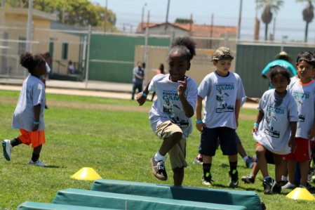 This young camper tries to get through this drill during the 7th Annual Marcedes Lewis Football Camp at Long Beach Poly High School on Saturday, June 20, 2015. Photo by Dennis J. Freeman/News4usonline.com