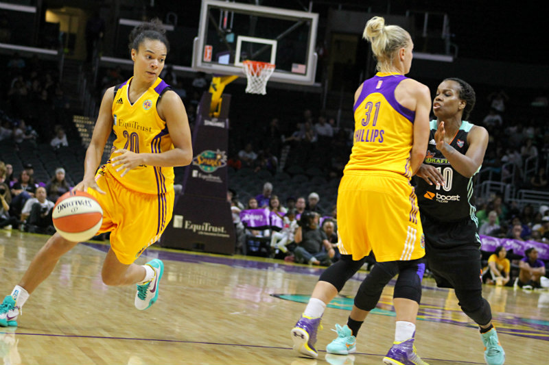 Sparks guard Kristi Toliver on the move against the New York Liberty. Photo by Dennis J. Freeman