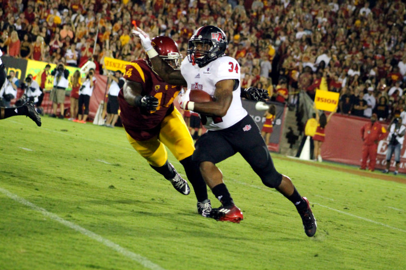 A USC defender looks to make a tackle against a Arkansas State runner. Photo by Dennis J. Freeman/News4usonline.com