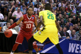 Jordan Woodard tries to make a play against Oregon as Oklahoma defeated the Ducks 80-68 to advance to the Final Four.