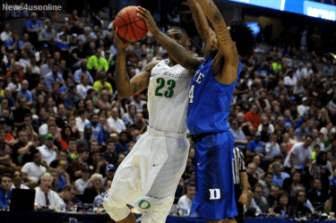 Elgin Cook goes up against Duke's Brandon Ingram for the layup in Oregon's take down of the Blue Devils in the Sweet 16.