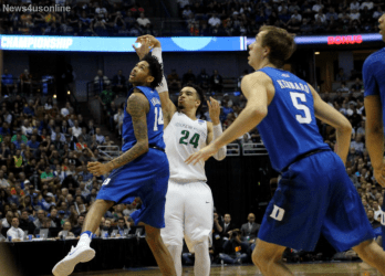 Dillon Brooks shoots over the outreached hand of Duke's Brandon Ingram in the NCAA Tournament's Sweet 16 game played at the Anaheim Honda Center in Anaheim, California.