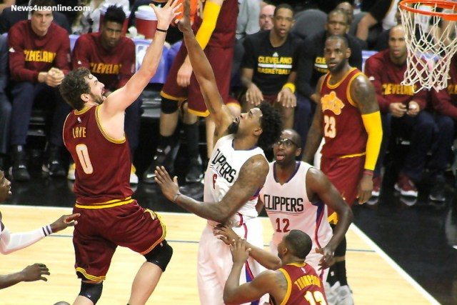 Cleveland Cavaliers forward Kevin Love goes to the basket with Clippers center DeAndre Jordan blocking his path.