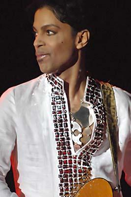 Prince performing at Coachella 2008. Photo courtesy of Wikipedia Commons/Michamedia