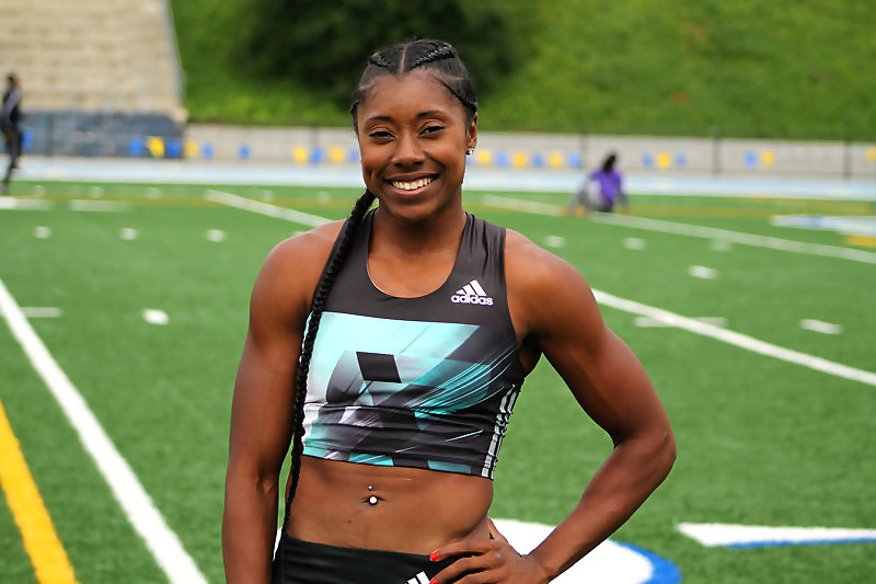 All smiles: LeKeisha Lawson after winning the 200 meters at the USATF San Diego/Imperial County Last Chance Qualifer track meet in June. Photo by Dennis J. Freeman/News4usonline