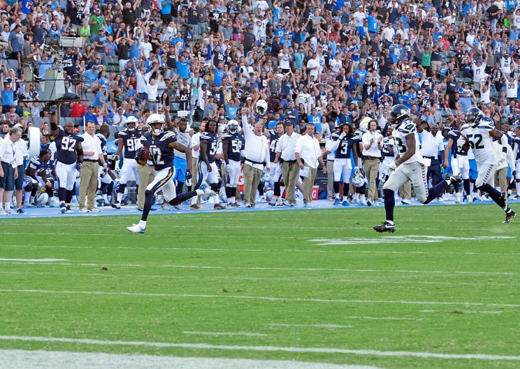 Chargers wide receiver Travis Benjamin scores on a 74-yard touchdown pass from Kellen Clemens. Photo by Astrud Reed/News4usonline