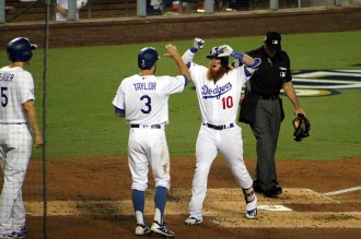 Los Angeles Dodgers third baseman Justin Turner celebrates his three-run home run in the first inning against the Arizona Diamondbacks in Game 1 of the National League Division Series. Photo by Dennis J. Freeman/News4usonline
