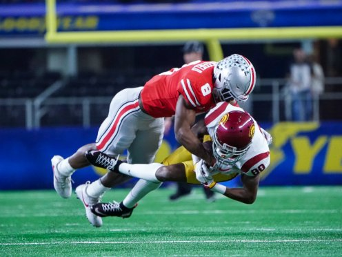 Ohio State defensive back Kendall Sheffield (8) lay down the hammer on USC wide receiver Deontay Burnett (80) during the 82nd Annual Goodyear Cotton Bowl Classic. Photo by Michael Lark for News4usonline