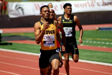 Iowa's Mar-Yea Harris hits the tape in the men's open 200 meters in 21.8 seconds. At the prep level, before he went to Iowa, Harris starred as a runner at Long Beach Poly High School and Long Beach Wilson. Photo by Dennis J. Freeman for News4usonline