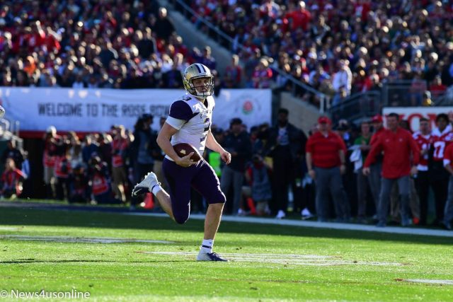 Jake Browning rushing the football in the Rose Bowl Game