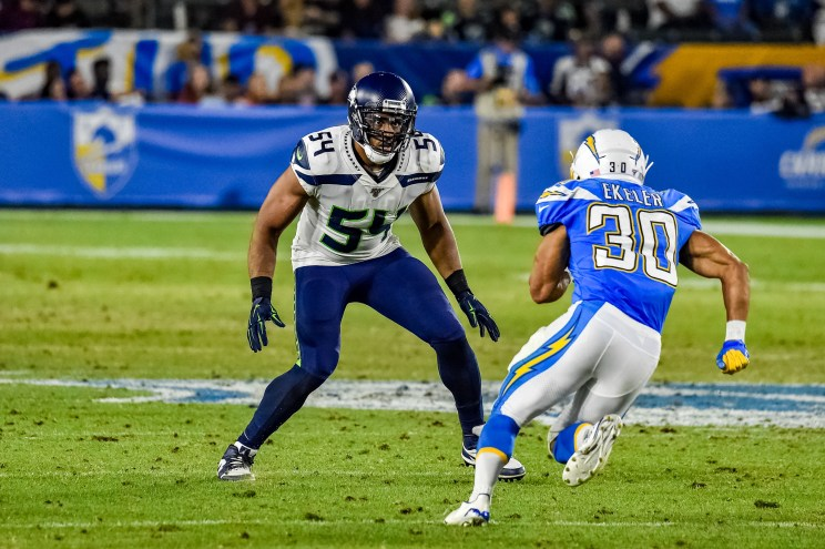 © Mark Hammond/News4usonline - Aug. 24, 2019 - Seahawks vs. Chargers - Chargers Austin Ekeler (30)  gets ready to run into Seattle linebacker Bobby Wagner (54).