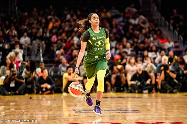 Former UCLA star and current Seattle Storm guard Jordin Canada brings the ball up the court against the Los Angeles Sparks at STAPLES Center. Photo credit: News4usonline