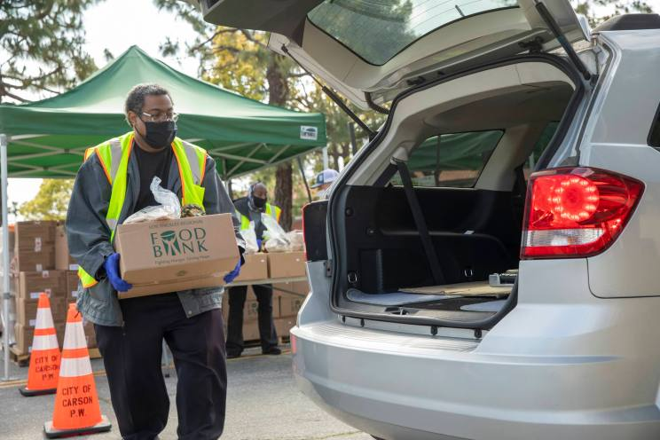 Los Angeles Regional Food Bank passes out food to residents in South Los Angeles